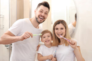 Young Family Brushing Teeth